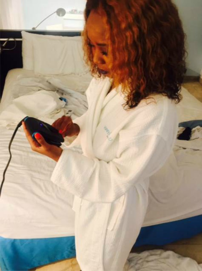 Keshia examining the Collar Perfect Touch -Up and Travel Iron