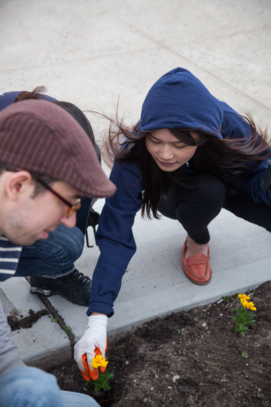UG employees planting flowers | UncommonGoods