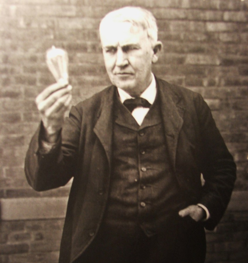 Thomas Edison holding a light bulb. Photo: National Park Service.