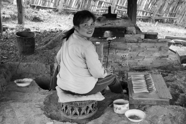 A Laotian artisan crafting from reclaimed metal.