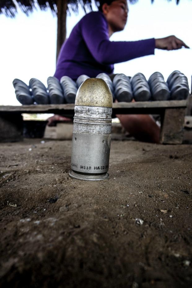 Laotian artisans transform bombs into beautiful jewelry.