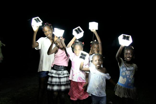 Children at an orphanage in Haiti using SolarPuffs