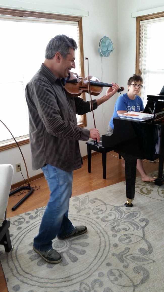 John Playing Violin