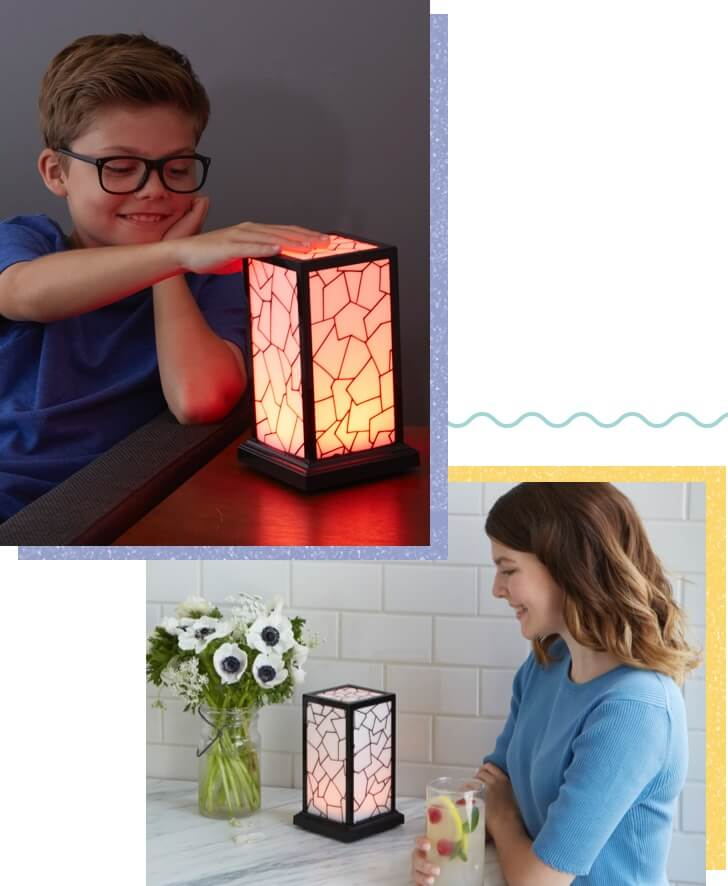 Boy taps Friendship Lamp. Young woman's lamp lights up. - small image