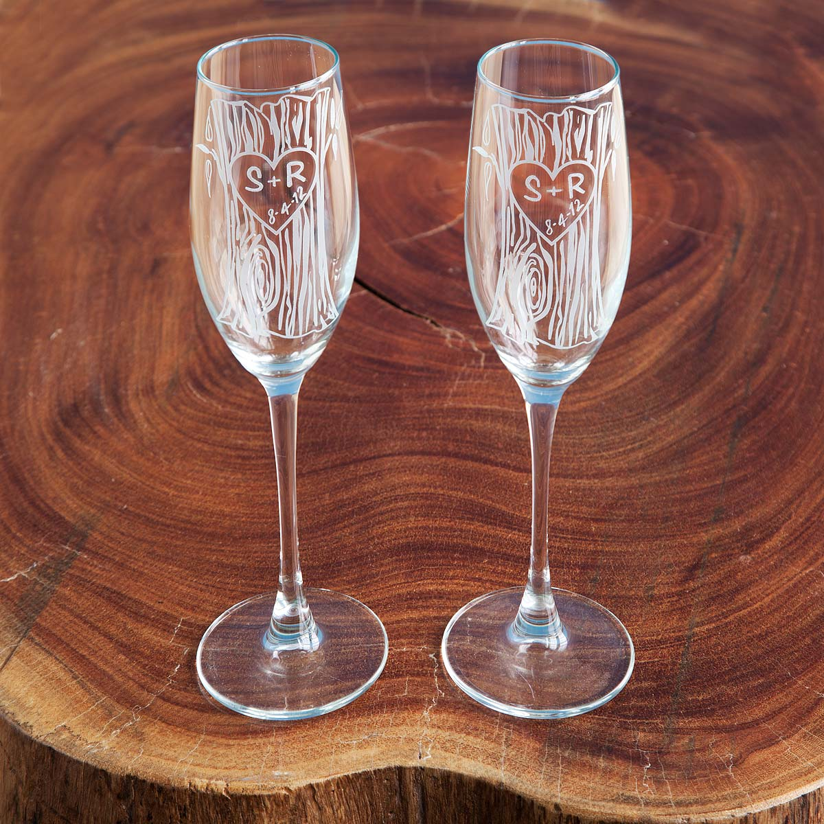 unique champagne flutes modern champagne glasses  uncommongoods - customizable etched champagne flutes  set of