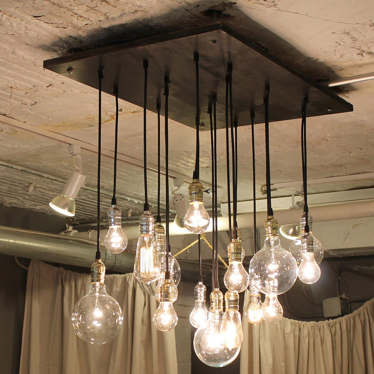 Industrial chandelier edison bulb industrial lighting uncommongoods industrial chandelier 1 thumbnail aloadofball Gallery