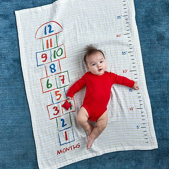 hopscotch-milestone-swaddle-blanket by uncommon-goods